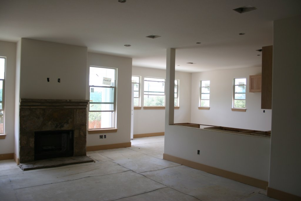 Main living area under construction (Gorgeous cut & stained concrete floors are protected with special coverings during construction)