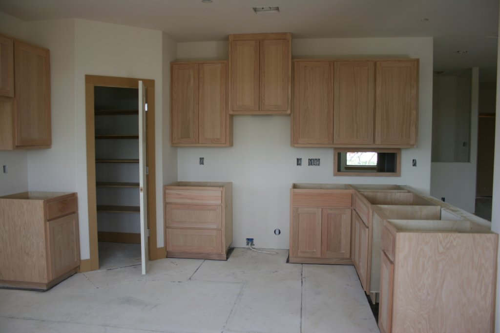 Kitchen under construction with custom made cabinetry stained on site