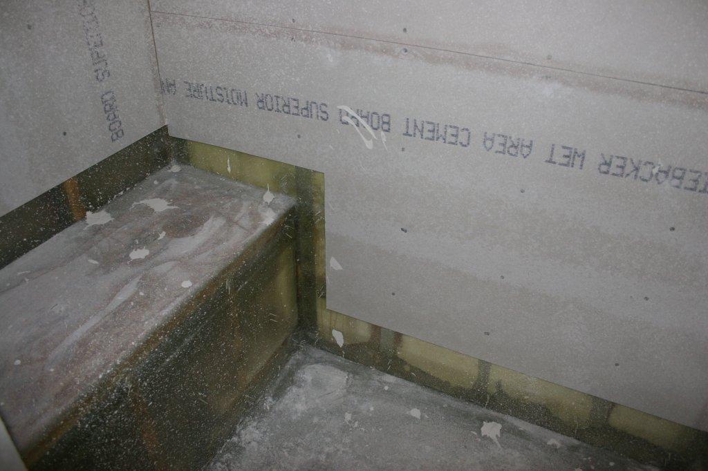 Custom seat & fiberglass work in master shower before tiling.
