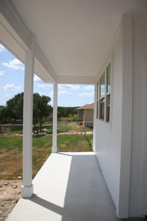 Back porch under construction. (ready for custom iron railings)