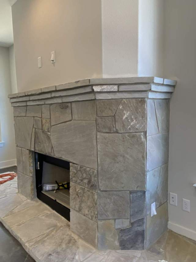 custom-rock-fireplace-with-TV-equipment-conduit