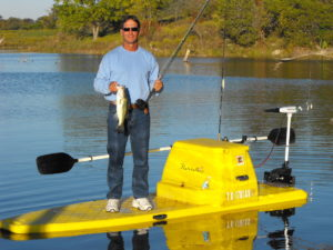 Roy Sanders on a flatstalker fishing for bass on a ranch lake